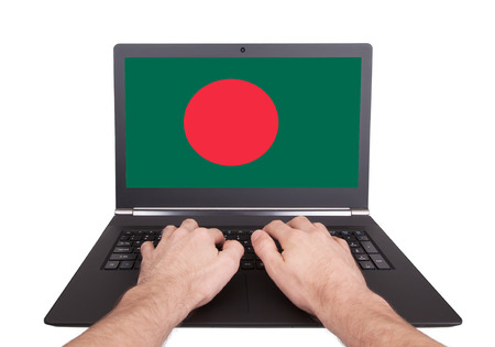 Hands working on laptop showing on the screen the flag of Bangladesh photo
