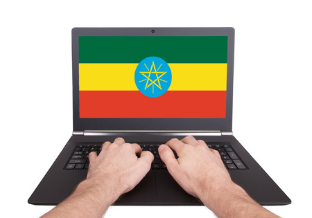 electronic voting: Hands working on laptop showing on the screen the flag of Ethiopia Stock Photo