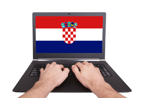 electronic voting: Hands working on laptop showing on the screen the flag of Croatia Stock Photo