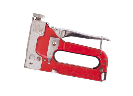 furniture hardware: Construction hand-held stapler, isolated on white background, red Stock Photo