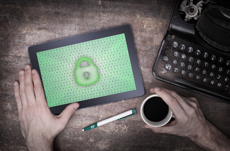 Tablet on a desk, concept of data protection photo