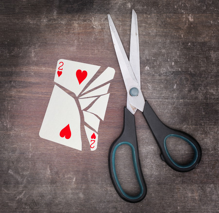 doublet: Concept of addiction, card with scissors