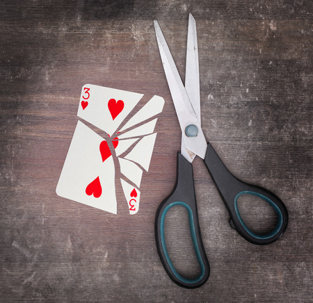 doublet: Concept of addiction, card with scissors, three of hearts