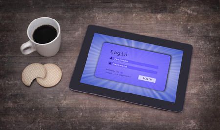 Login interface on tablet - username and password, blue photo