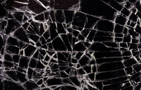 Full screen broken glass, black background horizontal