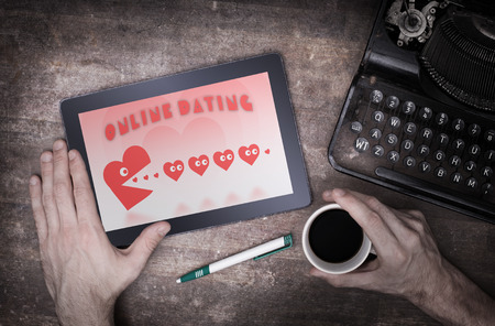 pacman: Online dating on a tablet - concept of love, red pacman eating hearts
