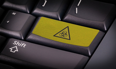 Symbol on button keyboard, warning (yellow) - biohazard photo