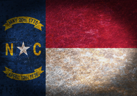 Old rusty metal sign with a flag - North Carolina photo