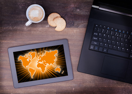 european community: World map on a tablet, concept of globalisation
