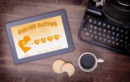 pacman: Online dating on a tablet - concept of love, yellow pacman eating hearts