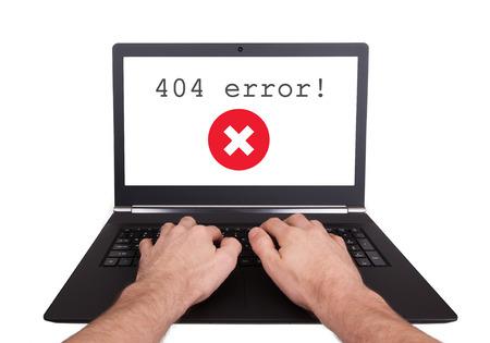 portable failure: Man working on laptop, 404 error, isolated