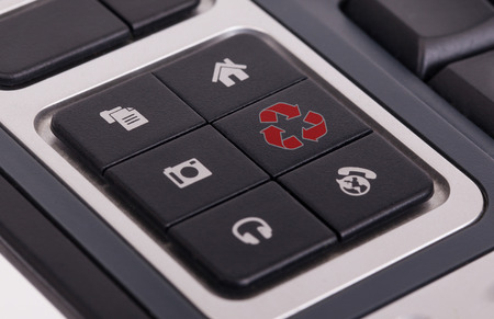 Buttons on a keyboard, selective focus on the middle right button - Recycle photo