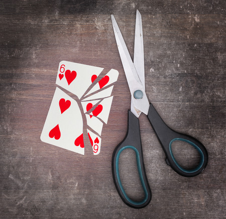 doublet: Concept of addiction, card with scissors, six of hearts