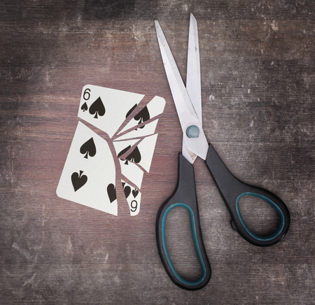 spades: Concept of addiction, card with scissors, six of spades