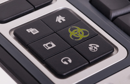 Buttons on a keyboard, selective focus on the middle right button - Biohazard photo