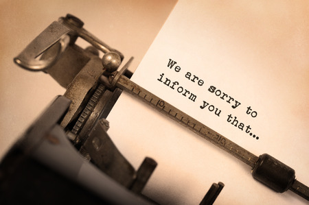 sorry: Vintage inscription made by old typewriter, We are sorry to inform you that Stock Photo