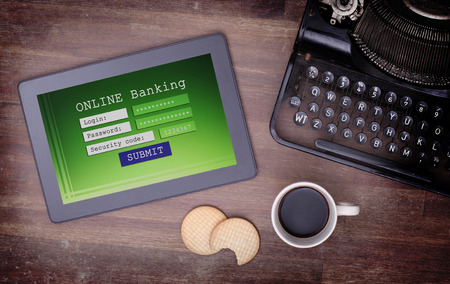 Online banking on a tablet - login, password and security code photo