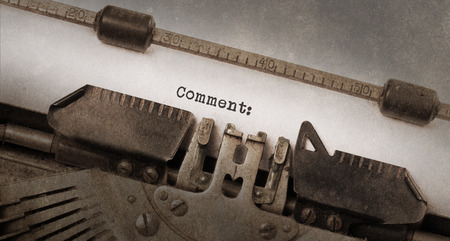 commenting: Vintage typewriter, old rusty and used, comment Stock Photo