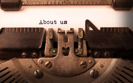 Vintage inscription made by old typewriter, about us photo