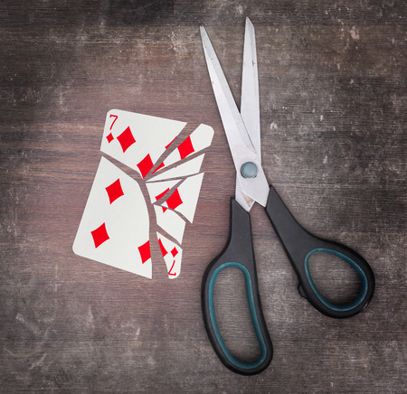 doublet: Concept of addiction, card with scissors, seven of diamond Stock Photo