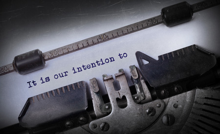 intention: Vintage inscription made by old typewriter, It is our intention to