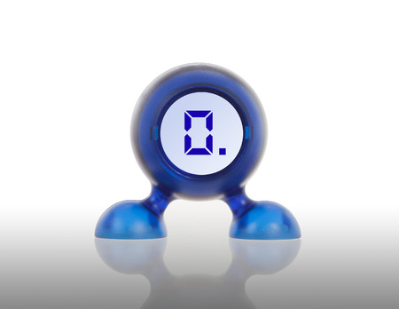 displaying: Small blue plastic object with a digital display, displaying 0 Stock Photo