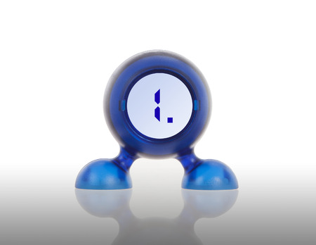 1 object: Small blue plastic object with a digital display, displaying 1 Stock Photo