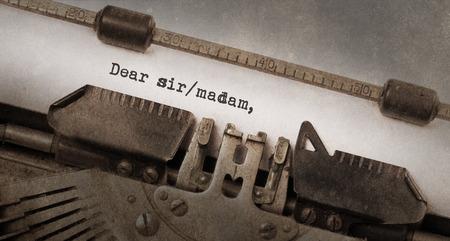 sir: Vintage typewriter, old rusty and used, dear sir madam