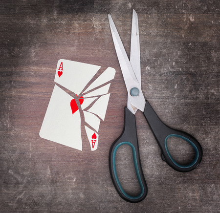 ace of hearts: Concept of addiction, card with scissors, ace of hearts