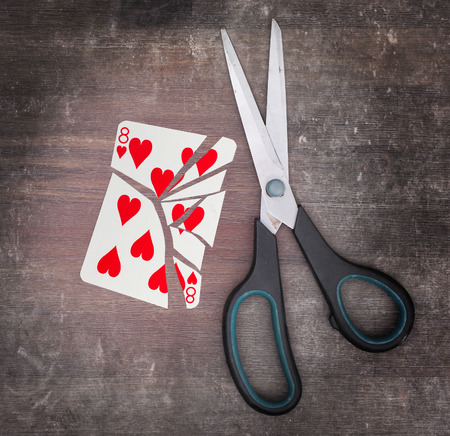 doublet: Concept of addiction, card with scissors, eight of hearts