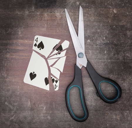 doublet: Concept of addiction, card with scissors, four of spades