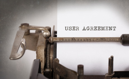 technology agreement: Vintage inscription made by old typewriter, User agreement Stock Photo