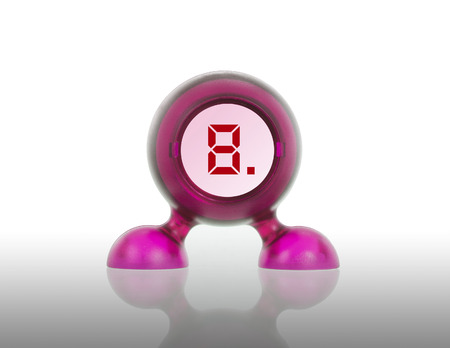 Small pink plastic object with a digital display, displaying 8 photo