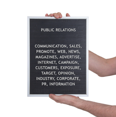 vintage look: Public relations concept in plastic letters on very old menu board, vintage look Stock Photo