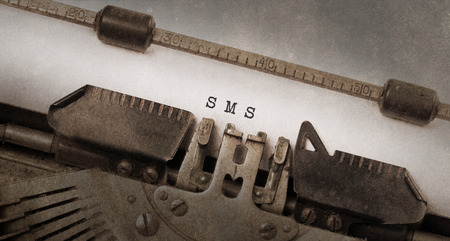 Vintage typewriter, old rusty and used, SMS photo