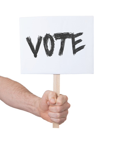 persepective: Hand holding sign, isolated on white - Vote Stock Photo