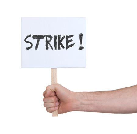 on strike: Hand holding sign, isolated on white - Strike Stock Photo
