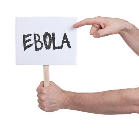 Hand holding sign, isolated on white - Ebola photo
