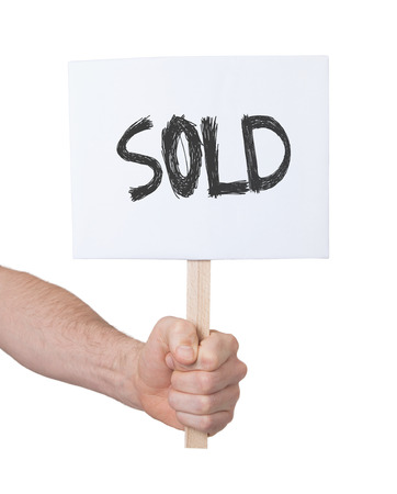 persepective: Hand holding sign, isolated on white - Sold