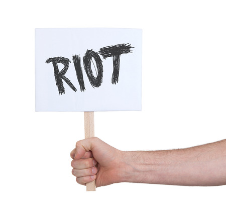 persepective: Hand holding sign, isolated on white - Riot Stock Photo