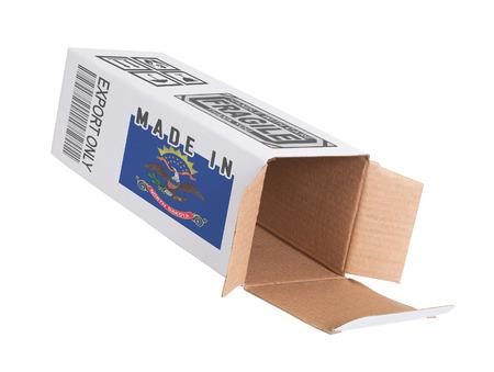 north dakota: Concept of export, opened paper box - Product of North Dakota