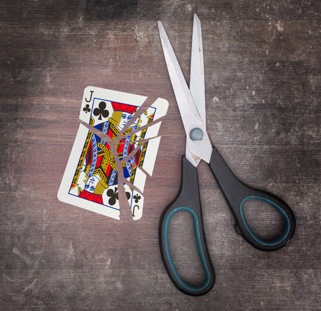jack of clubs: Concept of addiction, card with scissors, jack of clubs Stock Photo