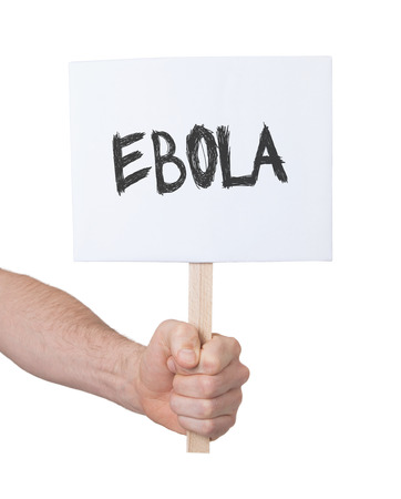 persepective: Hand holding sign, isolated on white - Ebola Stock Photo