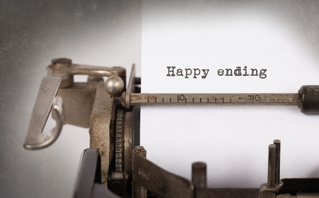 ending: Vintage inscription made by old typewriter, Happy ending Stock Photo