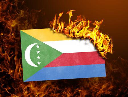 comoros: Flag burning - concept of war or crisis - Comoros Stock Photo