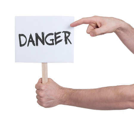 urgent announcement: Hand holding sign, isolated on white - Danger