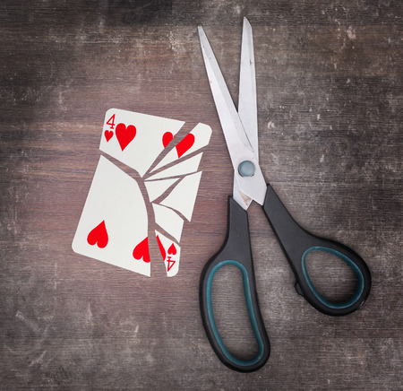 doublet: Concept of addiction, card with scissors, four of hearts