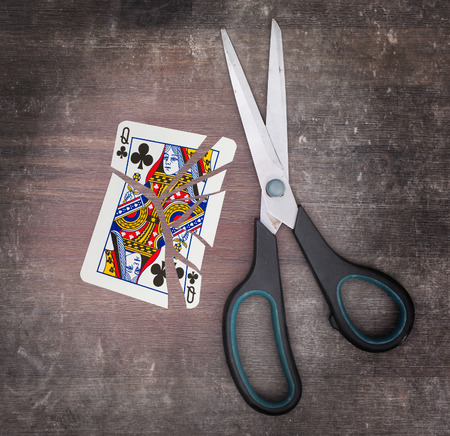 doublet: Concept of addiction, card with scissors, queen of clubs Stock Photo