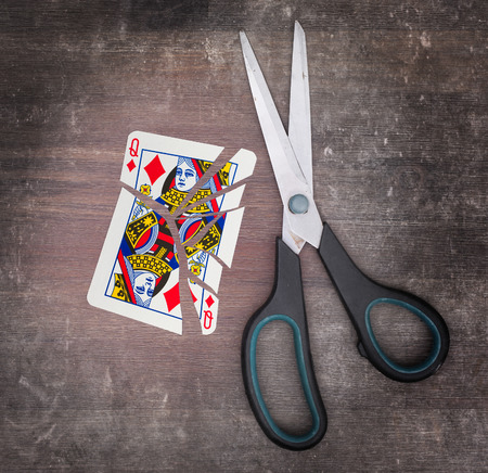 doublet: Concept of addiction, card with scissors, queen of diamond