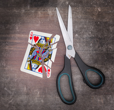 queen of hearts: Concept of addiction, card with scissors, queen of hearts